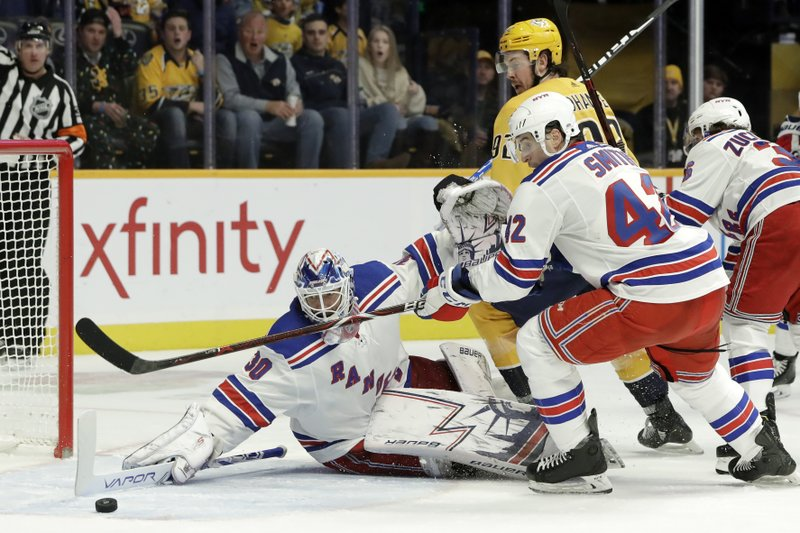 New York Rangers goaltender Henrik Lundqvist (30), of Sweden, reaches to block a shot against the Nashville Predators in the second period of an NHL hockey game Saturday, Dec. (AP Photo/Mark Humphrey)