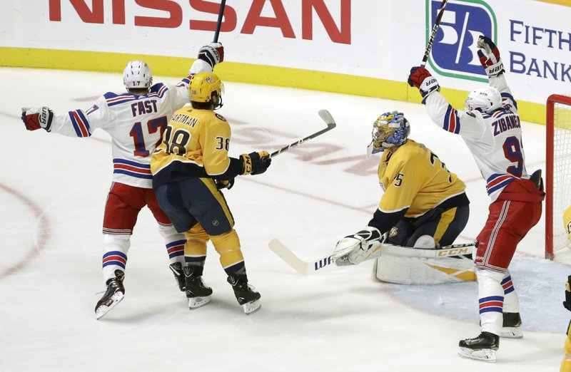New York Rangers right wing Jesper Fast (17), of Sweden, celebrates after scoring a goal against Nashville Predators goaltender Pekka Rinne (35), of Finland, in the second period of an NHL hockey game Saturday, Dec. (AP Photo/Mark Humphrey)