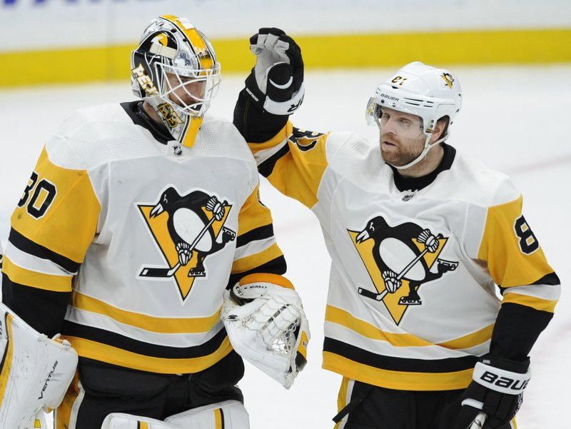 Pittsburgh Penguins goalie Matt Murray (30) is congratulated by Phil Dessel (81) after the team's 6-1 victory over the St. (AP Photo/Bill Boyce)