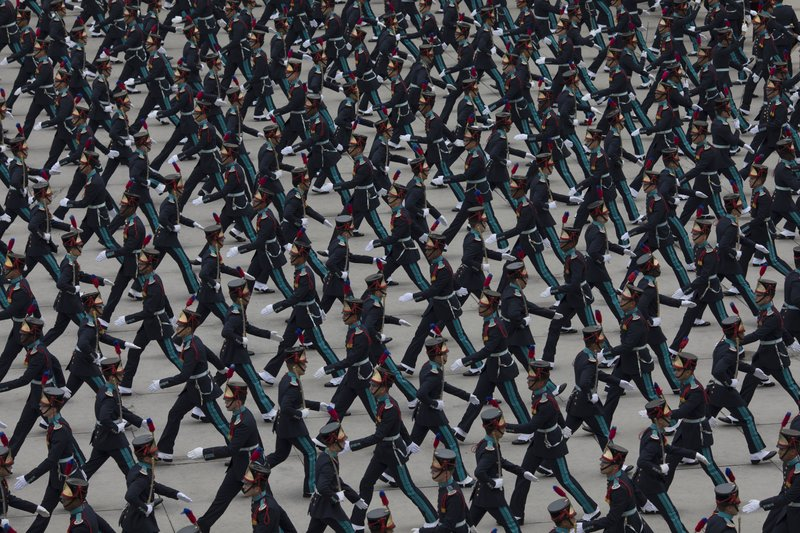 In this Dec. 1, 2018 photo, Army cadets march during their graduation ceremony at the Agulhas Negras Military Academy in Resende, Brazil. (AP Photo/Leo Correa)