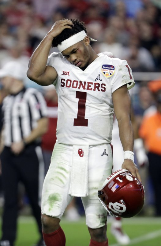 Oklahoma quarterback Kyler Murray (1) walks off the field after his helmet came off on a play, during the second half of the Orange Bowl NCAA college football game against Alabama, Saturday, Dec. (AP Photo/Lynne Sladky)