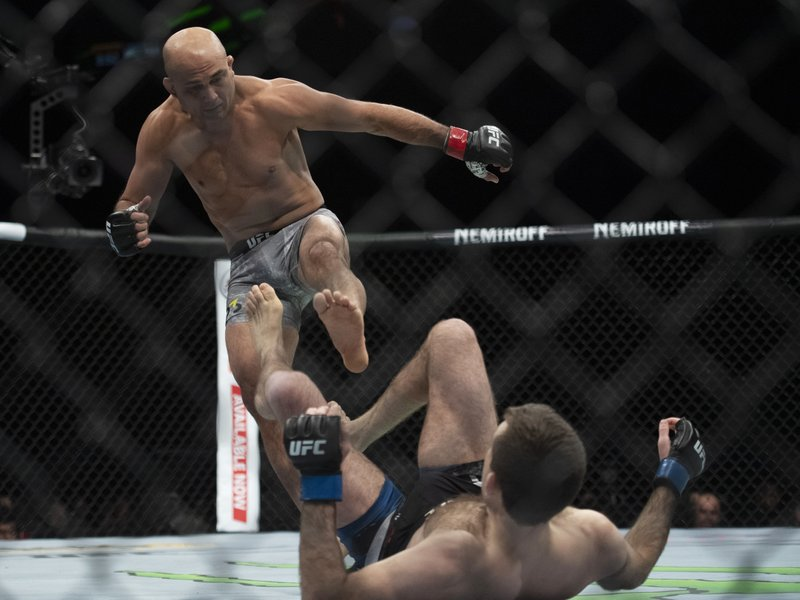 BJ Penn, top, fights Ryan Hall during the first round of a lightweight mixed martial arts bout at UFC 232, Saturday, Dec. (AP Photo/Kyusung Gong)
