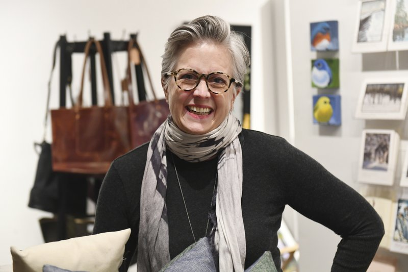 Mary Whitney, co-owner of Grand Hand Gallery at Dale Street and Grand Avenue in St. Paul, Minn. in her store on Wednesday, Dec. (John Autey/Pioneer Press via AP)
