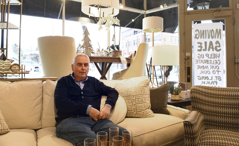 Mike Schumann, owner of Traditions Furniture on Grand Avenue in St. Paul, Minn. in his store on Thursday Dec. (John Autey/Pioneer Press via AP)