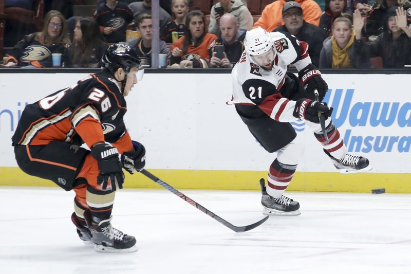 Arizona Coyotes center Derek Stepan, right, shoots past Anaheim Ducks defenseman Brandon Montour during the first period of an NHL hockey game in Anaheim, Calif. (AP Photo/Chris Carlson)