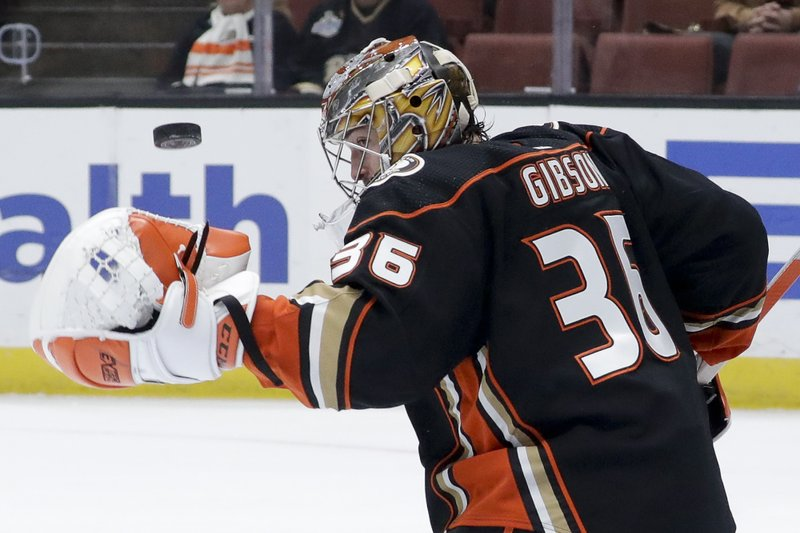 Anaheim Ducks goaltender John Gibson blocks a shot during the first period of an NHL hockey game against the Arizona Coyotes in Anaheim, Calif. (AP Photo/Chris Carlson)