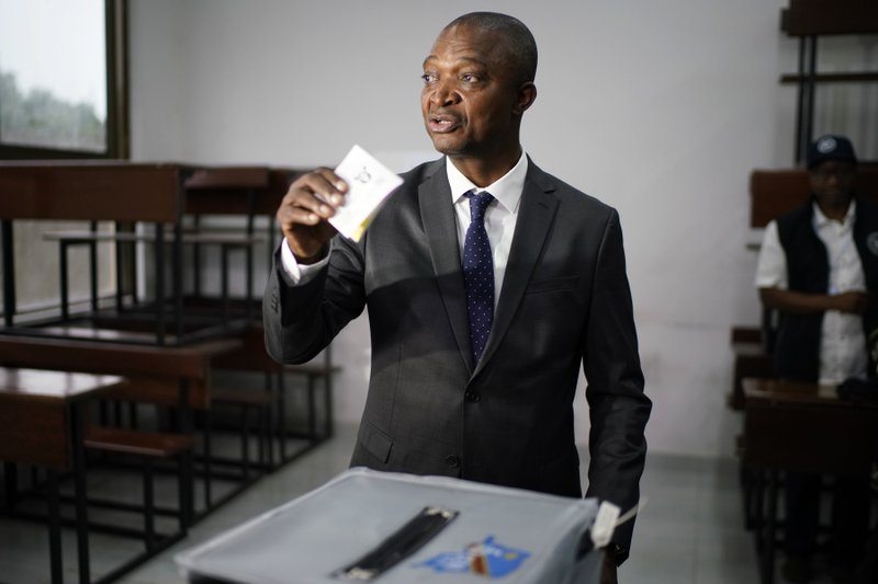 Ruling party presidential candidate Emmanuel Ramazani Shadary casts his vote Sunday, Dec. 30, 2018 in Kinshasa, Congo. (AP Photo/Jerome Delay)