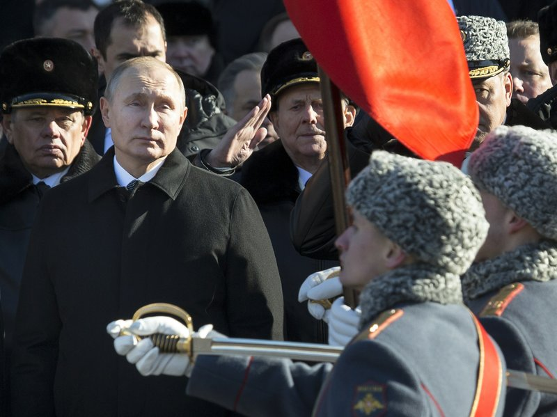 FILE In this file photo taken on Friday, Feb. 23, 2018, Russian President Vladimir Putin, left, attends a wreath-laying ceremony at the Tomb of the Unknown Soldier in Moscow, Russia. (AP Photo/Alexander Zemlianichenko, File)