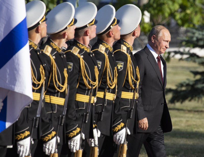 FILE - In this file photo taken on Thursday, Aug. 23, 2018, Russian President Vladimir Putin, right, arrives to attend a laying ceremony in Kursk, 426 kilometers (266 miles) south of Moscow, Russia. (AP Photo/Alexander Zemlianichenko, Pool, File)