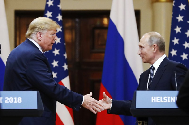 FILE In this file photo taken on Monday, July 16, 2018, U.S. President Donald Trump shakes hand with Russian President Vladimir Putin at the end of the press conference after their meeting at the Presidential Palace in Helsinki, Finland. (AP Photo/Alexander Zemlianichenko, File)
