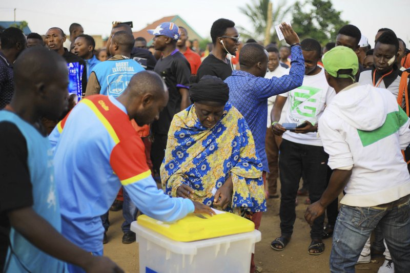 Congolese participate in a mock voting in the Eastern Congolese town of Beni Sunday Dec. 30, 2018. The delay of Sunday's election until March for Beni and Butembo city is blamed on a deadly Ebola outbreak. (AP Photo/Al-hadji Kudra Maliro)