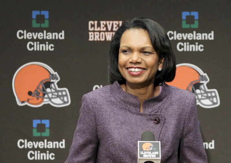 FILE- In this Oct. 21, 2010, file photo former Secretary of State Condoleezza Rice talks with the media after visiting with the Cleveland Browns coaches and players at the Browns training facility in Berea, Ohio. (AP Photo/Amy Sancetta, File)