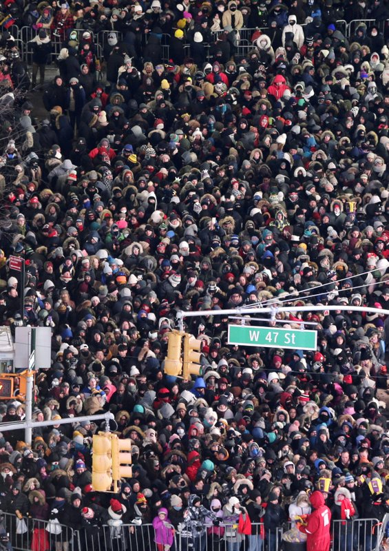FILE - In this Dec. 31, 2017, file photo, revelers wait for midnight during the New Year's Eve celebration in New York's Times Square as seen from above from the Marriott Marquis hotel. (AP Photo/Seth Wenig, File)
