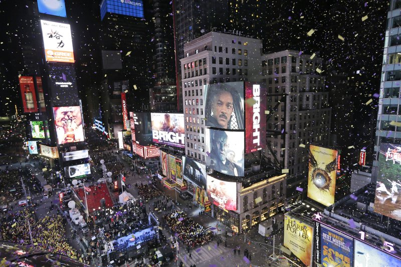 FILE - In this Jan. 1, 2018, file photo, confetti flies over Times Square during the New Year's celebration in New York. (AP Photo/Seth Wenig, File)