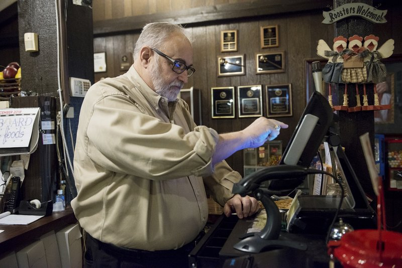 In this Tuesday, Dec. 18, 2018 photo, Mike Wiggins, owner of Granny Shaffer's, works at the restaurant in Joplin, Mo. (Roger Nomer/The Joplin Globe via AP)