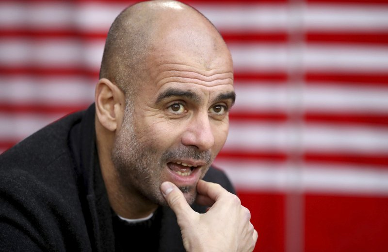 Manchester City manager Pep Guardiola looks out prior to the match against Southampton, during their English Premier League soccer match at St Mary's Stadium in Southampton, England, Sunday Dec. (Adam Davy/PA via AP)