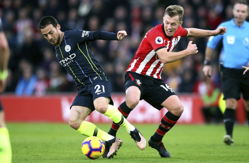 Manchester City's David Silva, left, and Southampton's James Ward-Prowse during their English Premier League soccer match at St Mary's Stadium in Southampton, England, Sunday Dec. (Adam Davy/PA via AP)