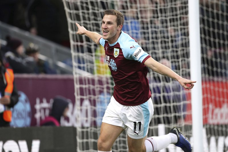 Burnley's Chris Wood celebrates scoring his side's first goal of the game against West Ham United, during their English Premier League soccer match at Turf Moor in Burnley, Sunday Dec. (Richard Sellers/PA via AP)
