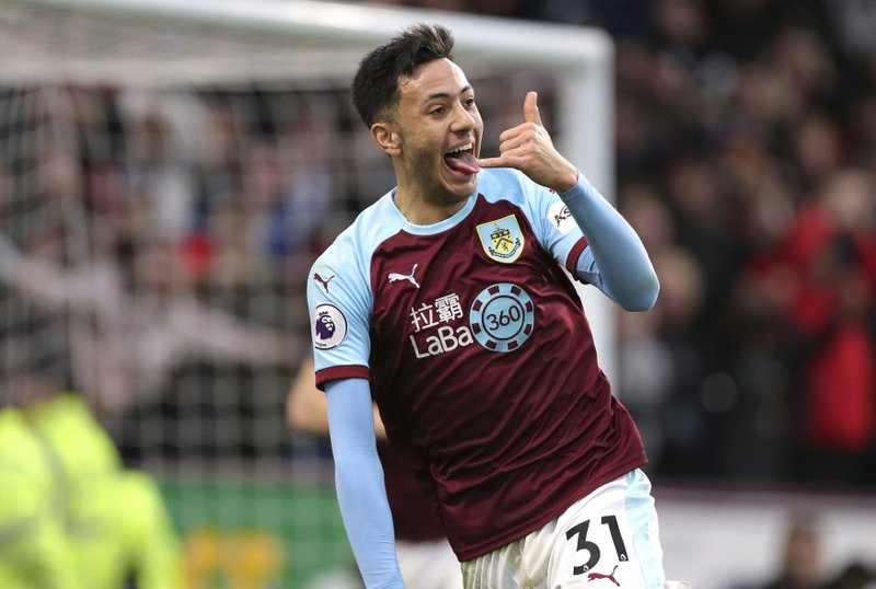 Burnley's Dwight McNeil celebrates scoring his side's second goal of the game against West Ham United, during their English Premier League soccer match at Turf Moor in Burnley, Sunday Dec. (Richard Sellers/PA via AP)