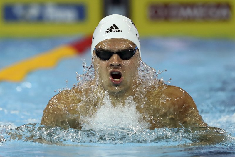 File-This Dec. 13, 2018, file photo shows Michael Andrew of the U.S., competing  in the heats for the Men's 100m individual medley during the 14th FINA World Swimming Championships in Hangzhou, China. (AP Photo/Ng Han Guan, File)