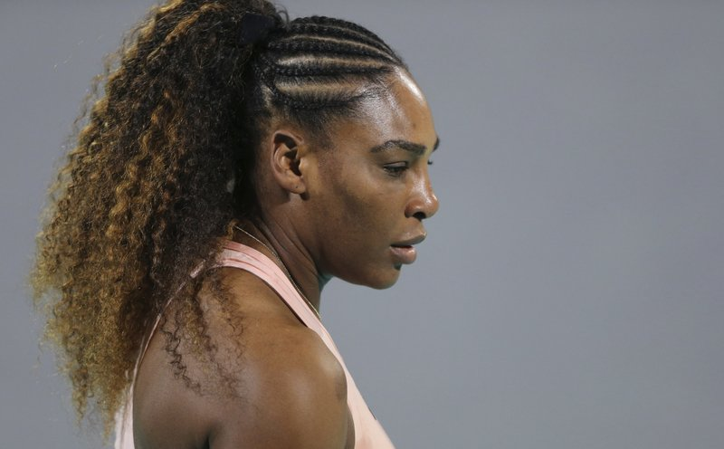 Serena Williams from the U.S. reacts during a match against her sister Venus, on the opening day of the Mubadala World Tennis Championship in Abu Dhabi, United Arab Emirates, Thursday, Dec. (AP Photo/Kamran Jebreili)