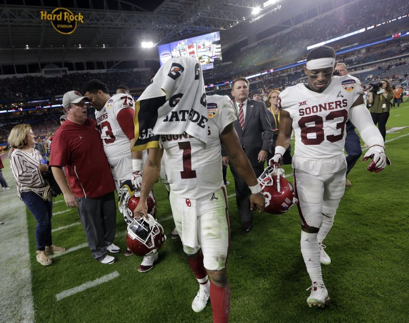Oklahoma quarterback Kyler Murray (1) leaves the field at the end during the second half of the Orange Bowl NCAA college football game, Saturday, Dec. (AP Photo/Lynne Sladky)