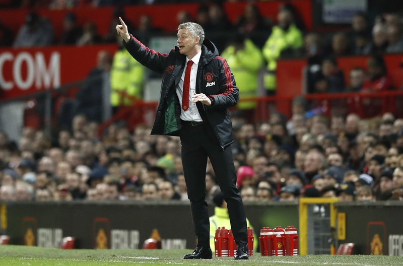 Manchester United interim manager Ole Gunnar Solskjaer gestures on the touchline during the match against Bournemouth, during their English Premier League soccer match at Old Trafford in Manchester, England, Sunday Dec. (Martin Rickett/PA via AP)