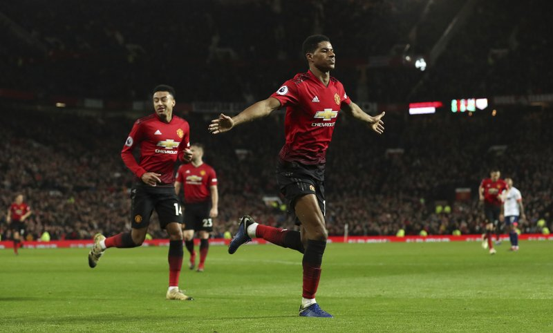 Manchester United's Marcus Rashford celebrates scoring his side's third goal of the game during the English Premier League soccer match between Manchester United and AFC Bournemouth at Old Trafford, Manchester, England, Sunday, Dec. (Martin Rickett/PA via AP)