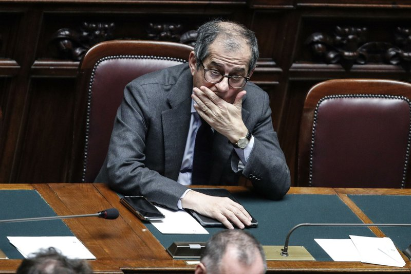 Italian Finance Minister Giovanni Tria attends a debate prior to a final vote to formally approve the 2019 budget law, at the Italian lower chamber of the Italian Parliament, in Rome, Sunday, Dec. (Giuseppe Lami/ANSA via AP)