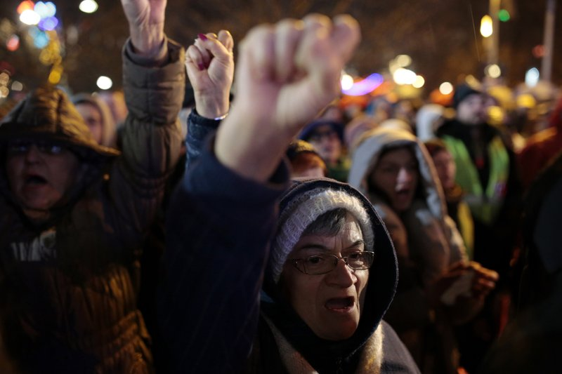 Protesters shout slogans including