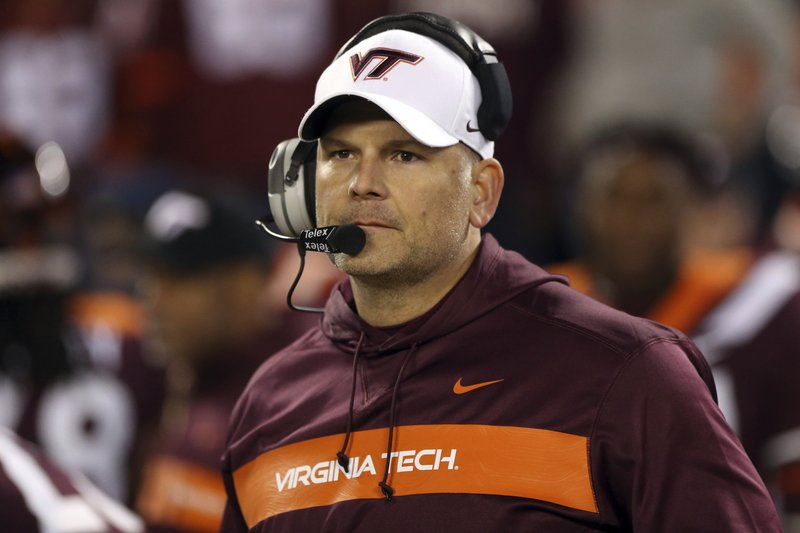 FILE - In this Oct. 25, 2018, file photo, Virginia Tech coach Justin Fuente awaits the start of the team's NCAA college football game against Georgia Tech in Blacksburg Va. (6-6) must defeat Cincinnati on Monday, Dec. 31, to avoid its first losing season since 1992. (Matt Gentry/The Roanoke Times via AP, File)