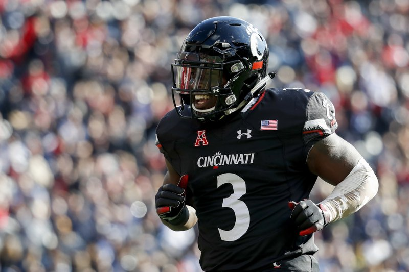 FILE - In a Saturday, Nov. 3, 2018 file photo, Cincinnati running back Michael Warren II celebrates after scoring a touchdown in the first half of an NCAA college football game against Navy, in Cincinnati. (6-6) must defeat Cincinnati in the Military Bowl on Monday, Dec. 31 to avoid its first losing season since 1992.(AP Photo/John Minchillo, File)