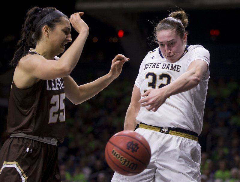 Notre Dame's Jessica Shepard (32) saves the ball from going out of bounds next to Lehigh's Emma Grothaus (25) during the first half of an NCAA college basketball game Sunday, Dec. (AP Photo/Robert Franklin)