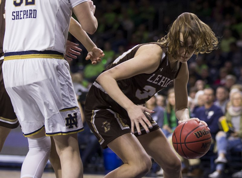 Lehigh's Cameryn Benz (30) turns downcourt with the ball after grabbing a rebound during the first half of an NCAA college basketball game against Notre Dame Sunday, Dec. (AP Photo/Robert Franklin)