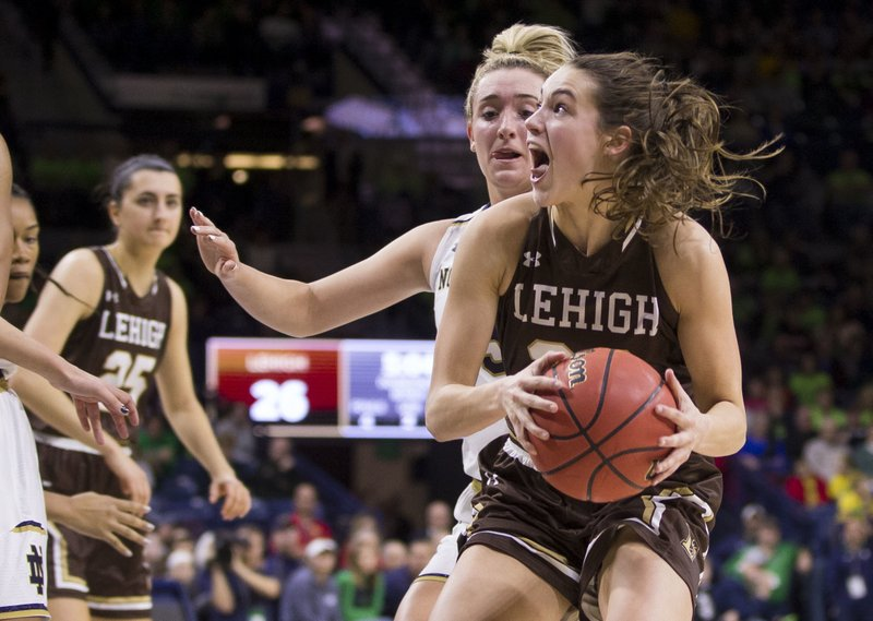 Lehigh's Hannah Hedstrom, front right, drives to the basket in front of Notre Dame's Marina Mabrey during the first half of an NCAA college basketball game Sunday, Dec. (AP Photo/Robert Franklin)