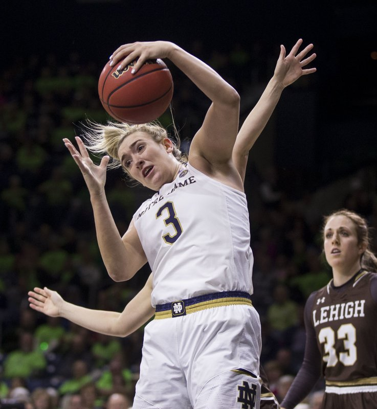 Notre Dame's Marina Mabrey (3) grabs a rebound in front of Lehigh's Hannah Hedstrom and Hailey Pascoe (33) during the first half of an NCAA college basketball game Sunday, Dec. (AP Photo/Robert Franklin)