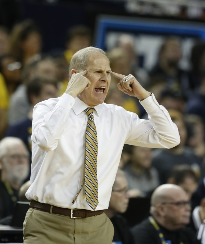 Michigan head coach John Beilein reacts after a call during the first half of an NCAA college basketball game against Binghamton, Sunday, Dec. (AP Photo/Carlos Osorio)