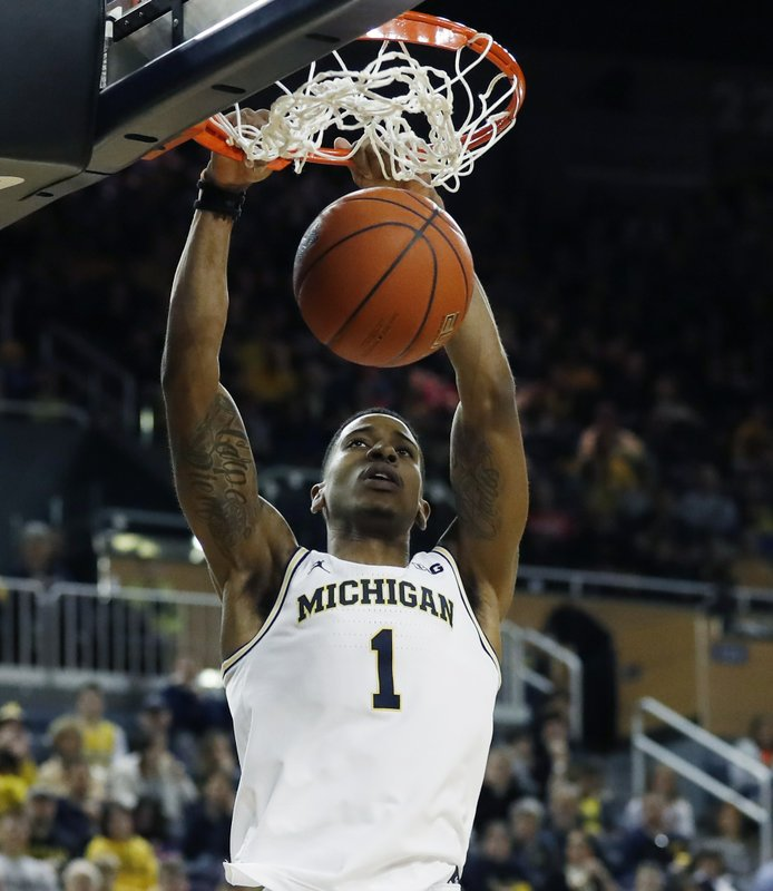 Michigan guard Charles Matthews dunks during the second half of an NCAA college basketball game against Binghamton, Sunday, Dec. (AP Photo/Carlos Osorio)
