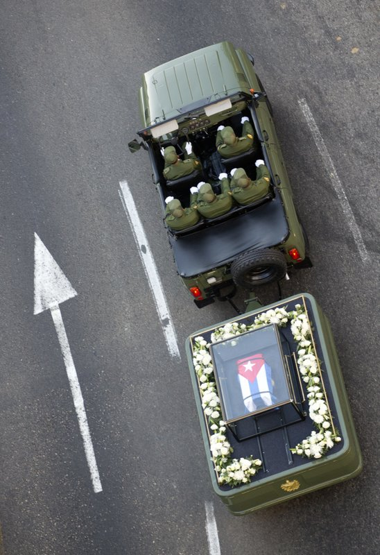 FILE - In this Nov. 30, 2016 file photo, a small, Cuban flag covered coffin containing the remains of Cuban leader Fidel Castro is pulled by a military vehicle through Havana, Cuba. (AP Photo/Desmond Boylan, File)