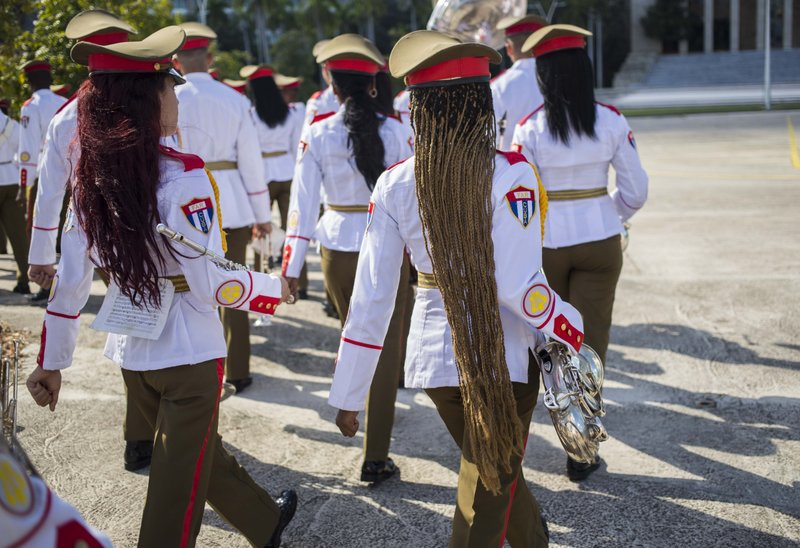 FILE - In this Oct. 25, 2018 file photo, the honor guard military band march after the arrival of El Salvador's President Salvador Sanchez Ceren at Revolution Square in Havana, Cuba. (AP Photo/Desmond Boylan, File)