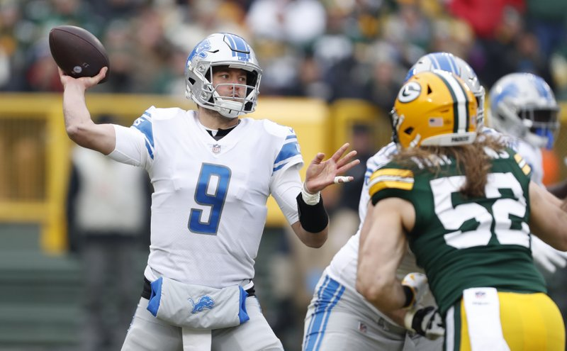 CORRECTS TO REMOVE SCORE- Detroit Lions' Matthew Stafford throws during the first half of an NFL football game against the Green Bay Packers Sunday, Dec. (AP Photo/Matt Ludtke)