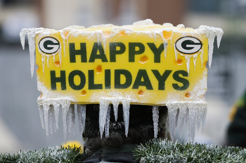 CORRECTS TO REMOVE SCORE- Fans tailgate before an NFL football game between the Green Bay Packers and the Detroit Lions Sunday, Dec. (AP Photo/Mike Roemer)
