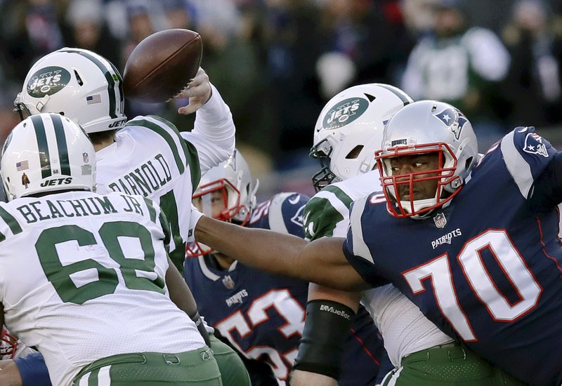 New England Patriots defensive tackle Adam Butler, right, forces a fumble by New York Jets quarterback Sam Darnold during the second half of an NFL football game, Sunday, Dec. (AP Photo/Charles Krupa)