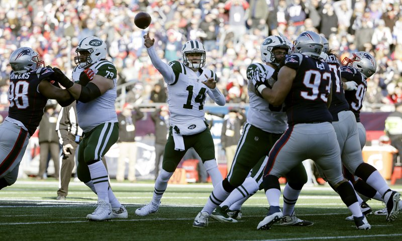 New York Jets quarterback Sam Darnold (14) passes against the New England Patriots during the first half of an NFL football game, Sunday, Dec. (AP Photo/Steven Senne)