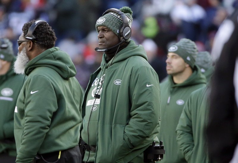 New York Jets head coach Todd Bowles watches from the sideline during the first half of an NFL football game against the New England Patriots, Sunday, Dec. (AP Photo/Steven Senne)