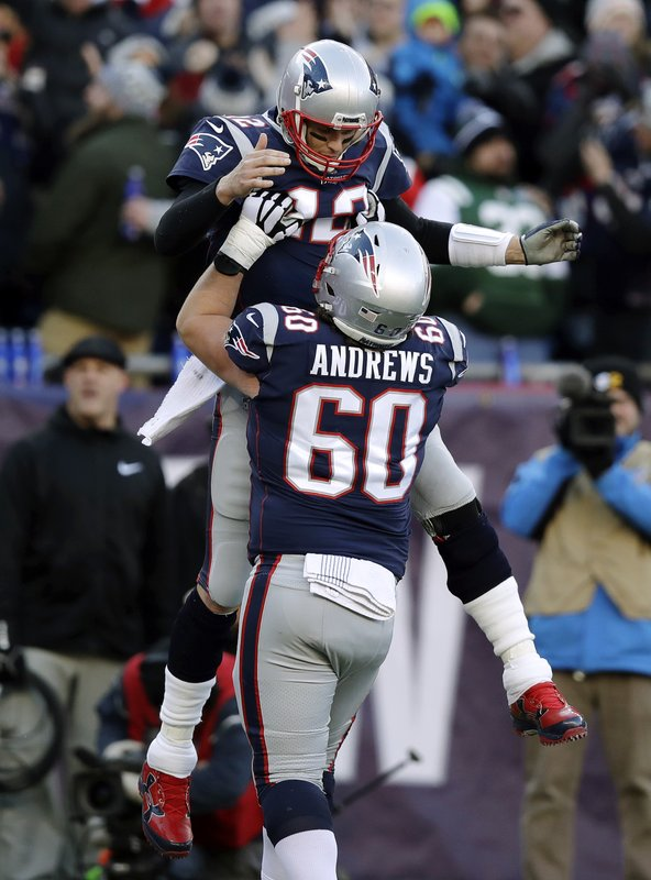 New England Patriots quarterback Tom Brady, top, gets a lift from center David Andrews as they celebrate Brady's touchdown pass to Phillip Dorsett during the first half of an NFL football game against the New York Jets, Sunday, Dec. (AP Photo/Charles Krupa)