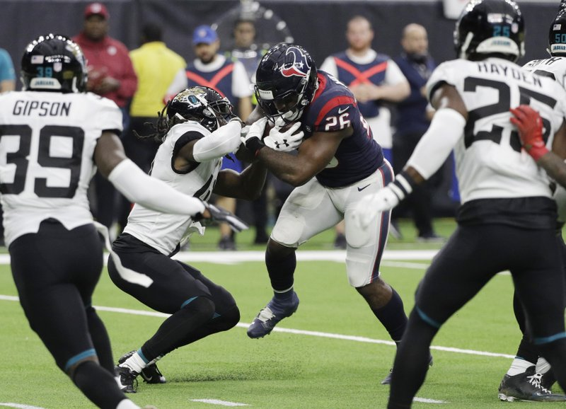 Houston Texans running back Lamar Miller (26) runs for a touchdown against the Jacksonville Jaguars during the first half of an NFL football game, Sunday, Dec. (AP Photo/David J. Phillip)