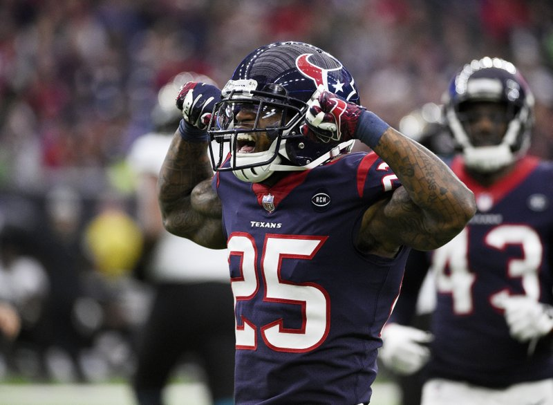 Houston Texans defensive back Jermaine Kelly (35) celebrates after making a stop against the Jacksonville Jaguars during the second half of an NFL football game, Sunday, Dec. (AP Photo/Eric Christian Smith)