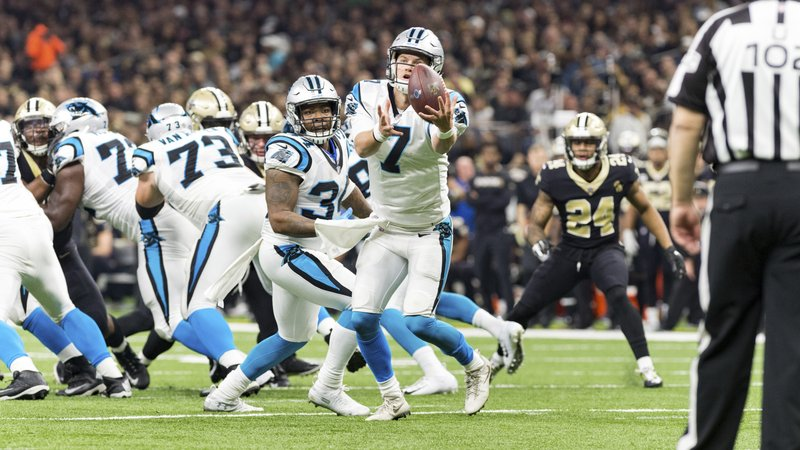Carolina Panthers quarterback Kyle Allen recovers a snap during an NFL football game against the New Orleans Saints in New Orleans, Sunday, Dec. (Scott Clause/The Daily Advertiser via AP)