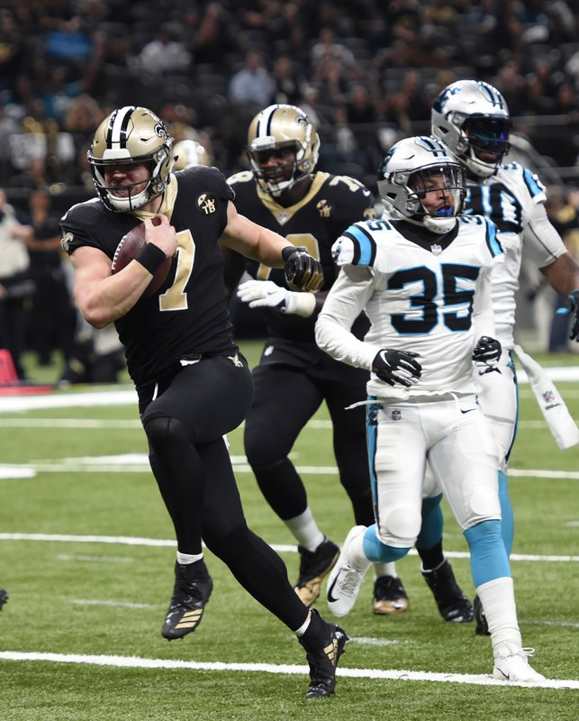 New Orleans Saints quarterback Taysom Hill (7) carries for a touchdown in front of Carolina Panthers cornerback Corn Elder (35) in the second half of an NFL football game in New Orleans, Sunday, Dec. (AP Photo/Bill Feig)